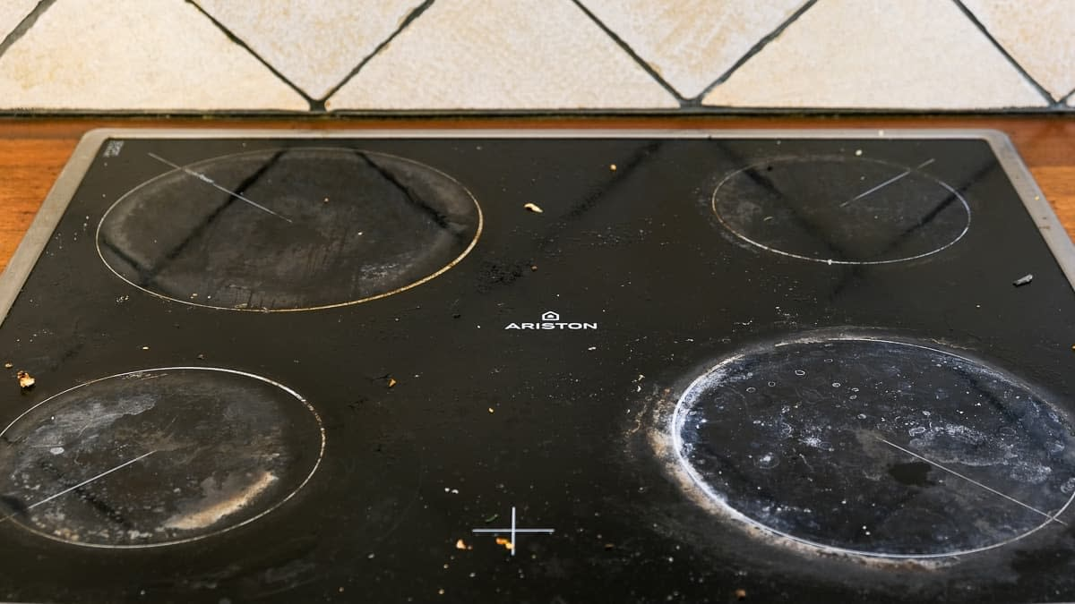 burnt and dirty vitroceramic stove top after heavy usage