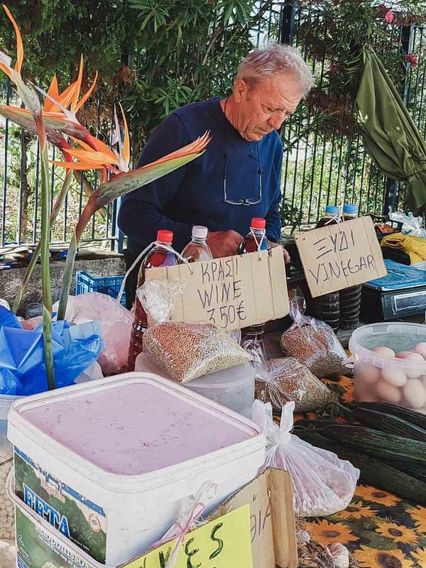 greek merchant selling fresh eggs and olive oil