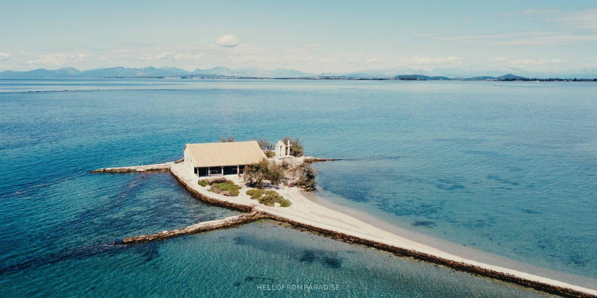 A church built on an islet surrounded by turquoise sea in Greece
