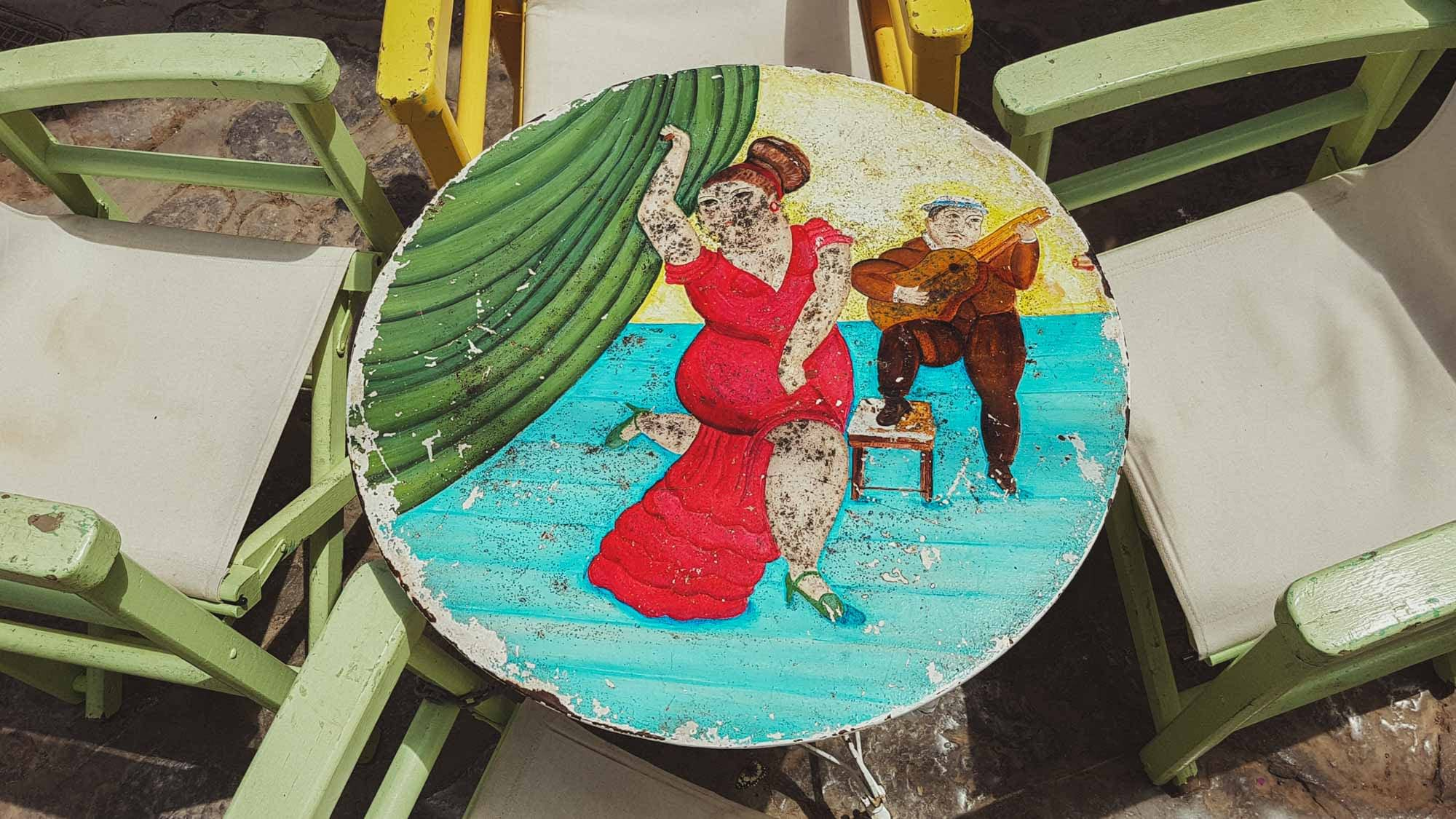 old wooden taverna table painted in hydra island greece
