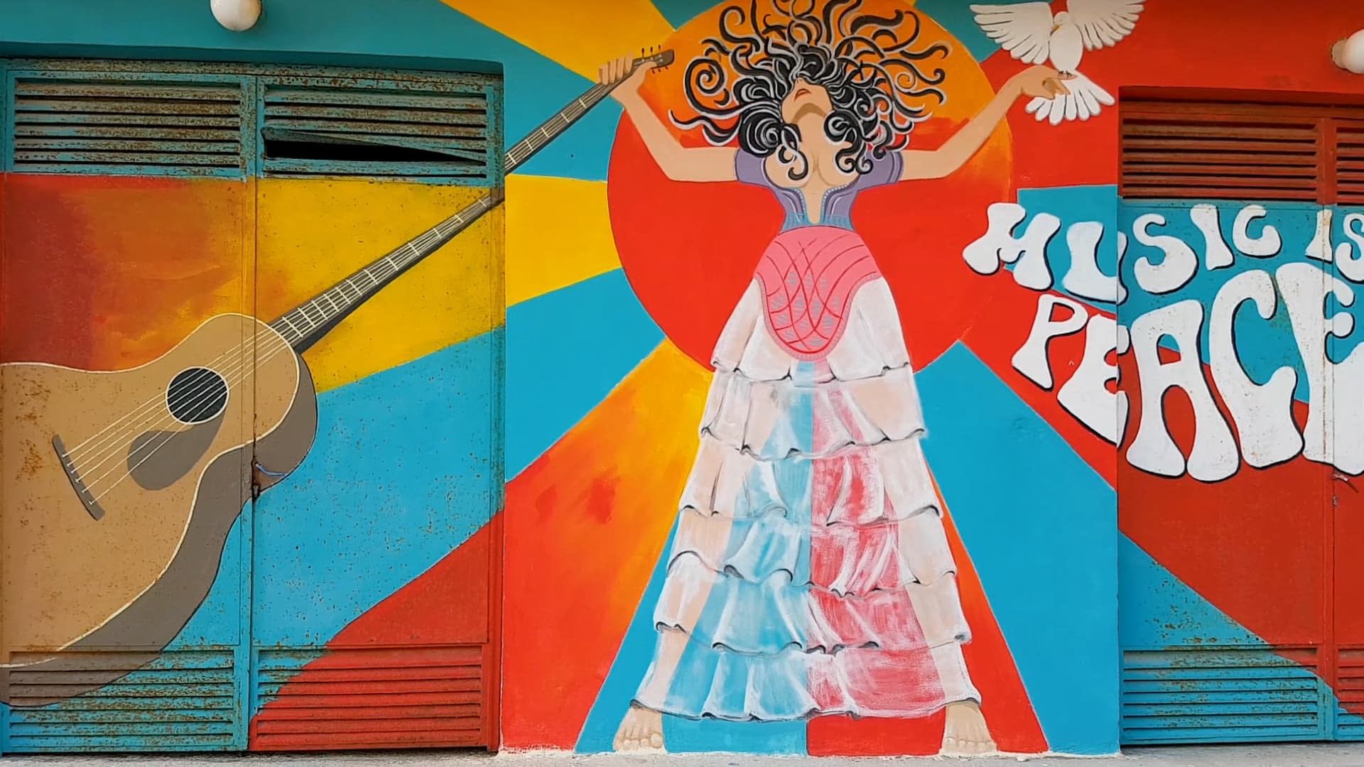 Hippie wall art in Matala with the slogan: Music is my weapon, Peace is in my soul