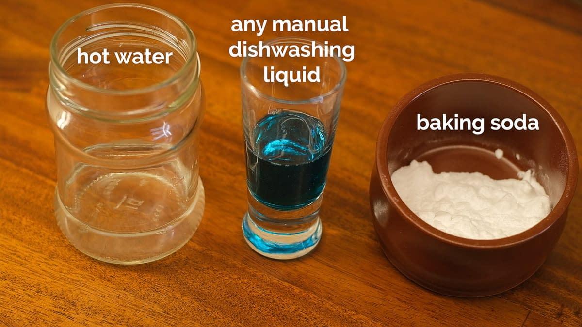 Baking soda next to dishwashing liquid and hot water