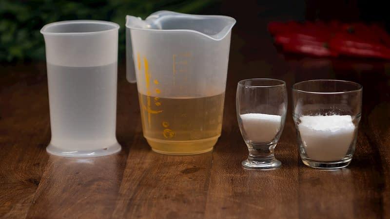 brine ingredients for pickled cucumbers: water, vinegar, salt and sugar
