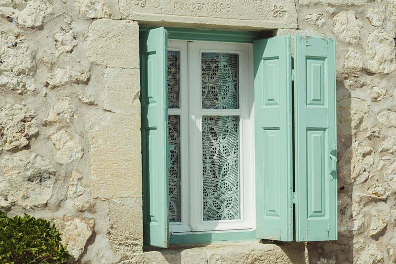 traditional wooden windows stone house