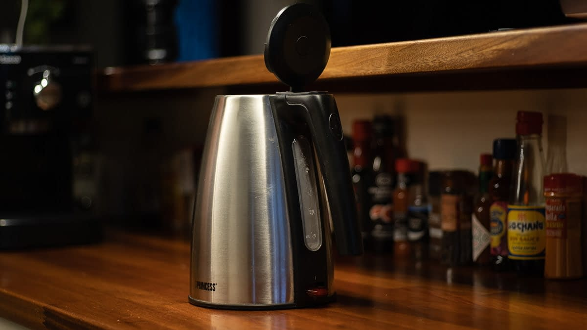 silver-colored-kettle-on-wooden-countertop
