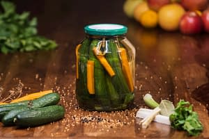 Jar of homemade sweet and sour pickled cucumbers. An old family recipe for pickling beginners.
